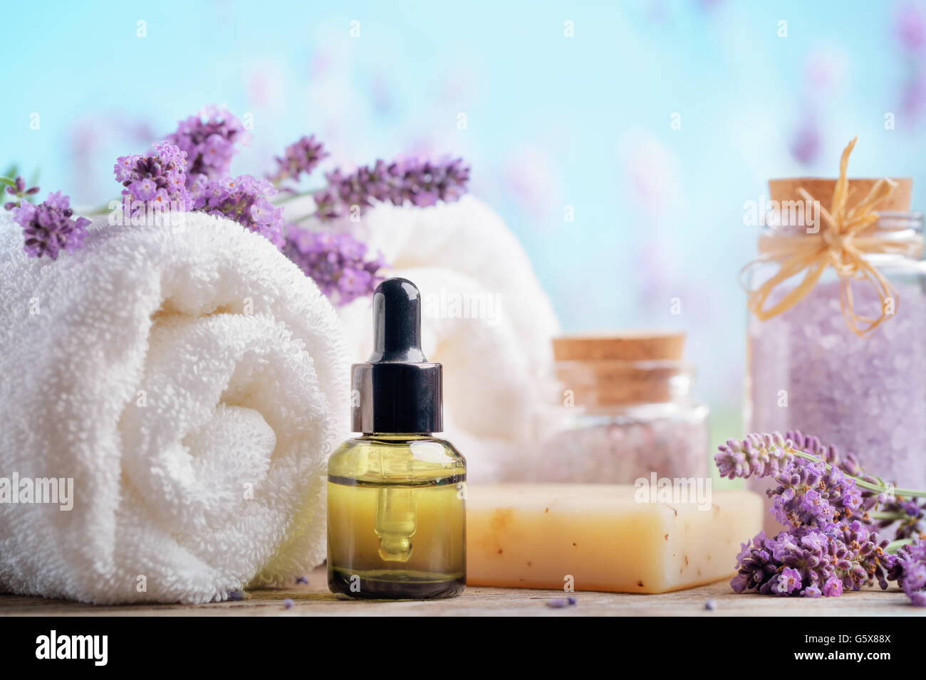 Essential oil, seasalt,towels and handmade soap - Stock Image