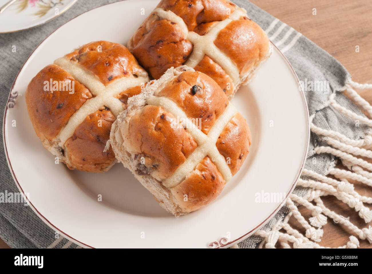 Hot Cross Buns traditionally eaten hot or toasted during Lent - Stock Image