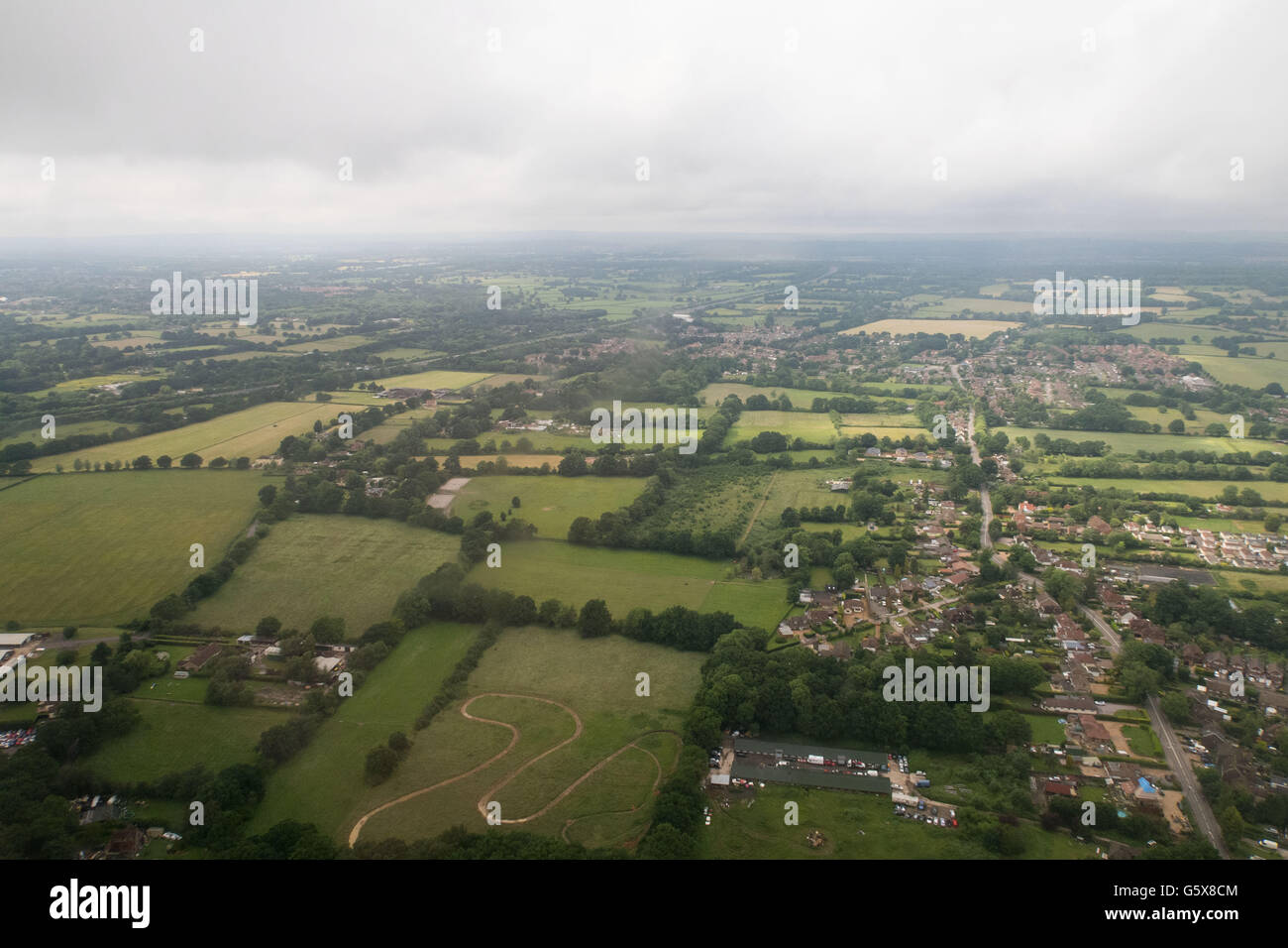 An aerial view of fields and houses on the approach to Gatwick airport, London Stock Photo