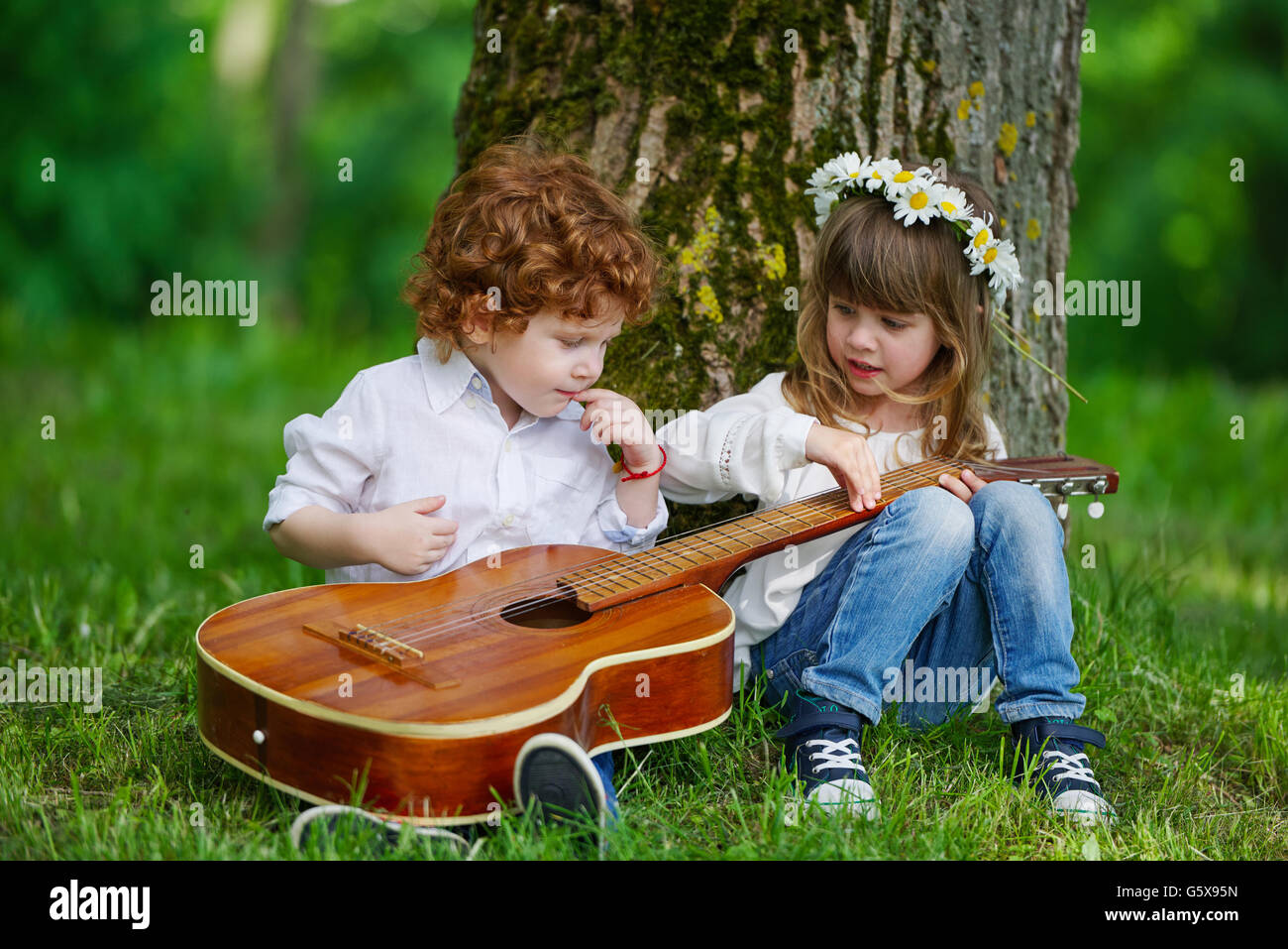 cute children playing guitar stock photo: 106913457 - alamy