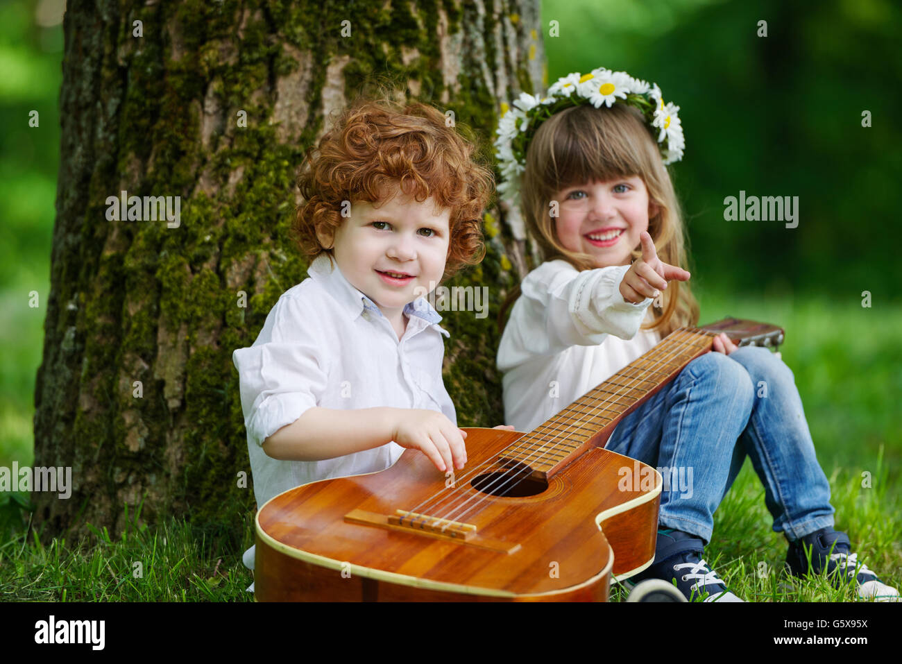 cute children playing guitar stock photo: 106913462 - alamy