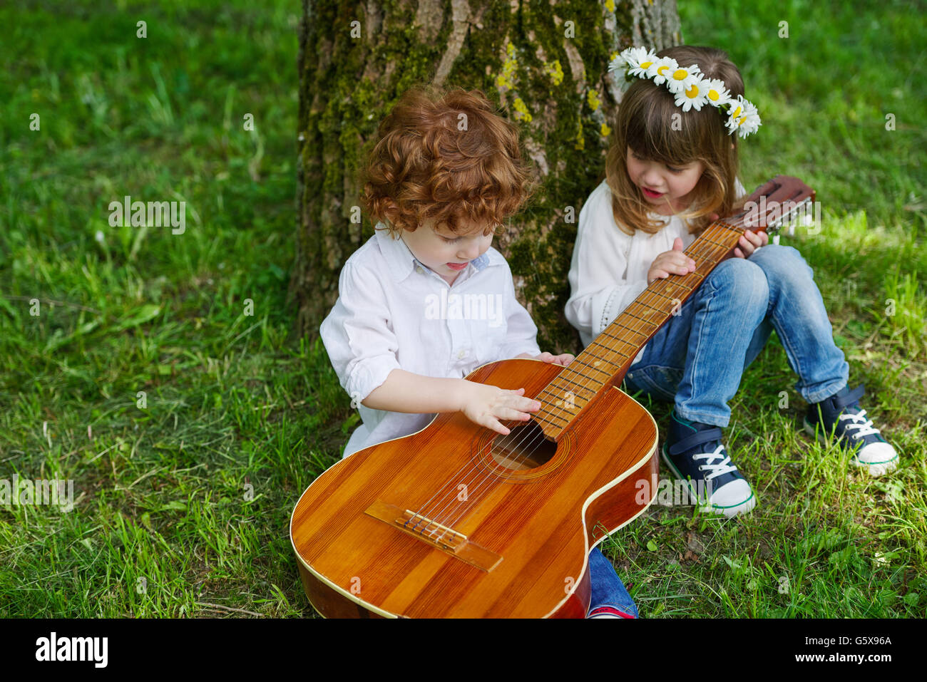 cute children playing guitar stock photo 106913474 alamy. Black Bedroom Furniture Sets. Home Design Ideas
