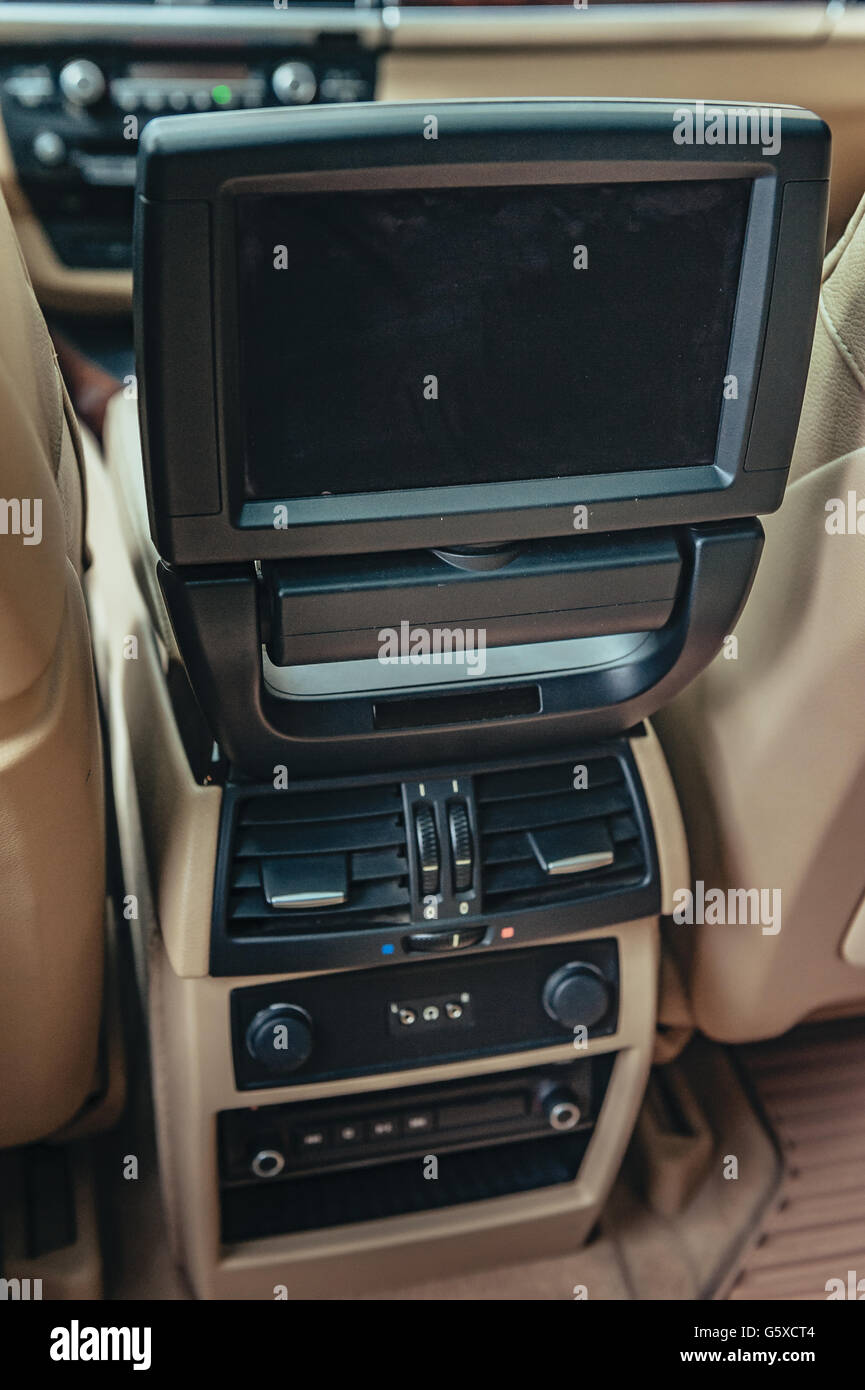 monitor car at rear seat. Television inside an automobile - Stock Image