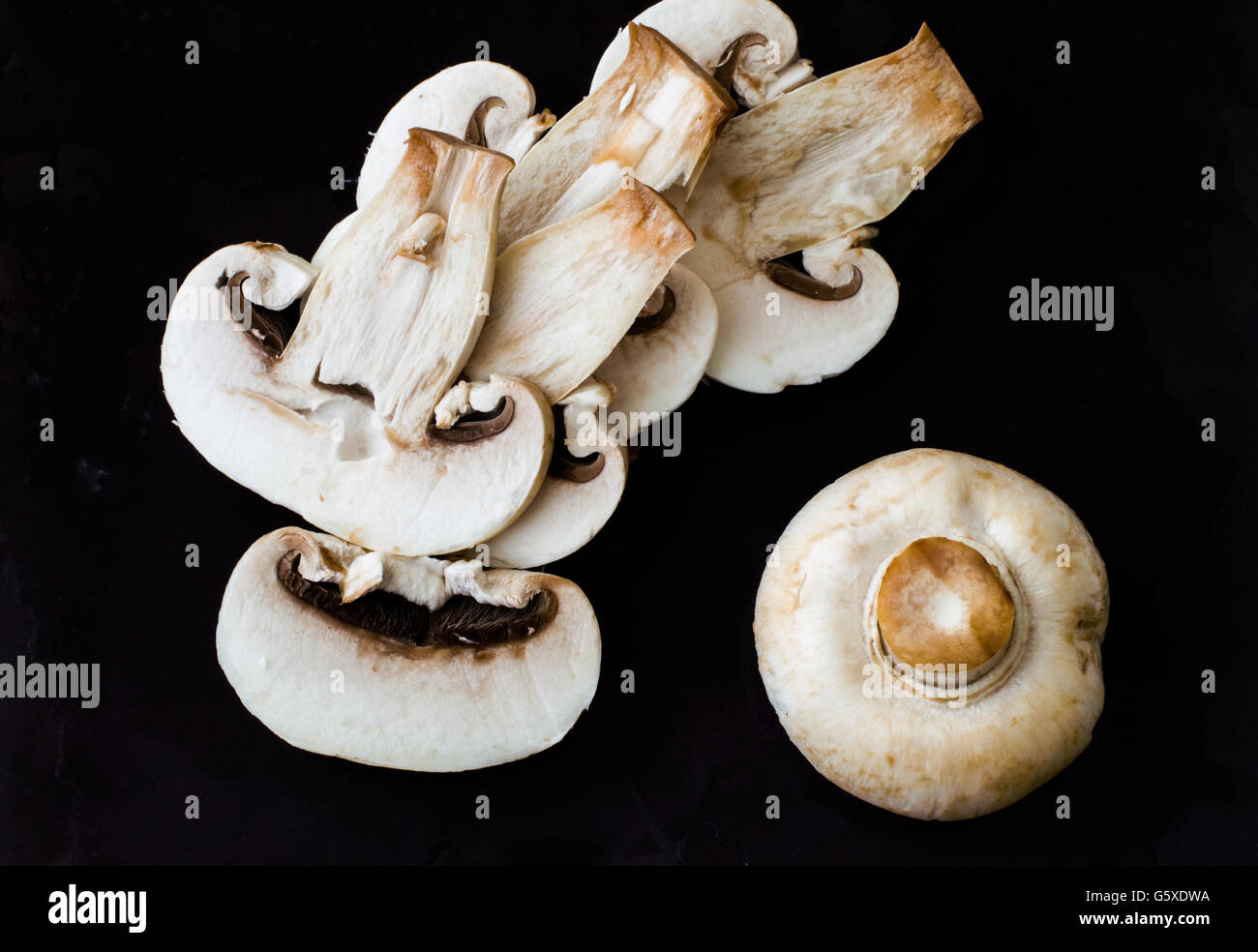 Top View of Sliced Fresh Mushrooms Before Cooking - Stock Image