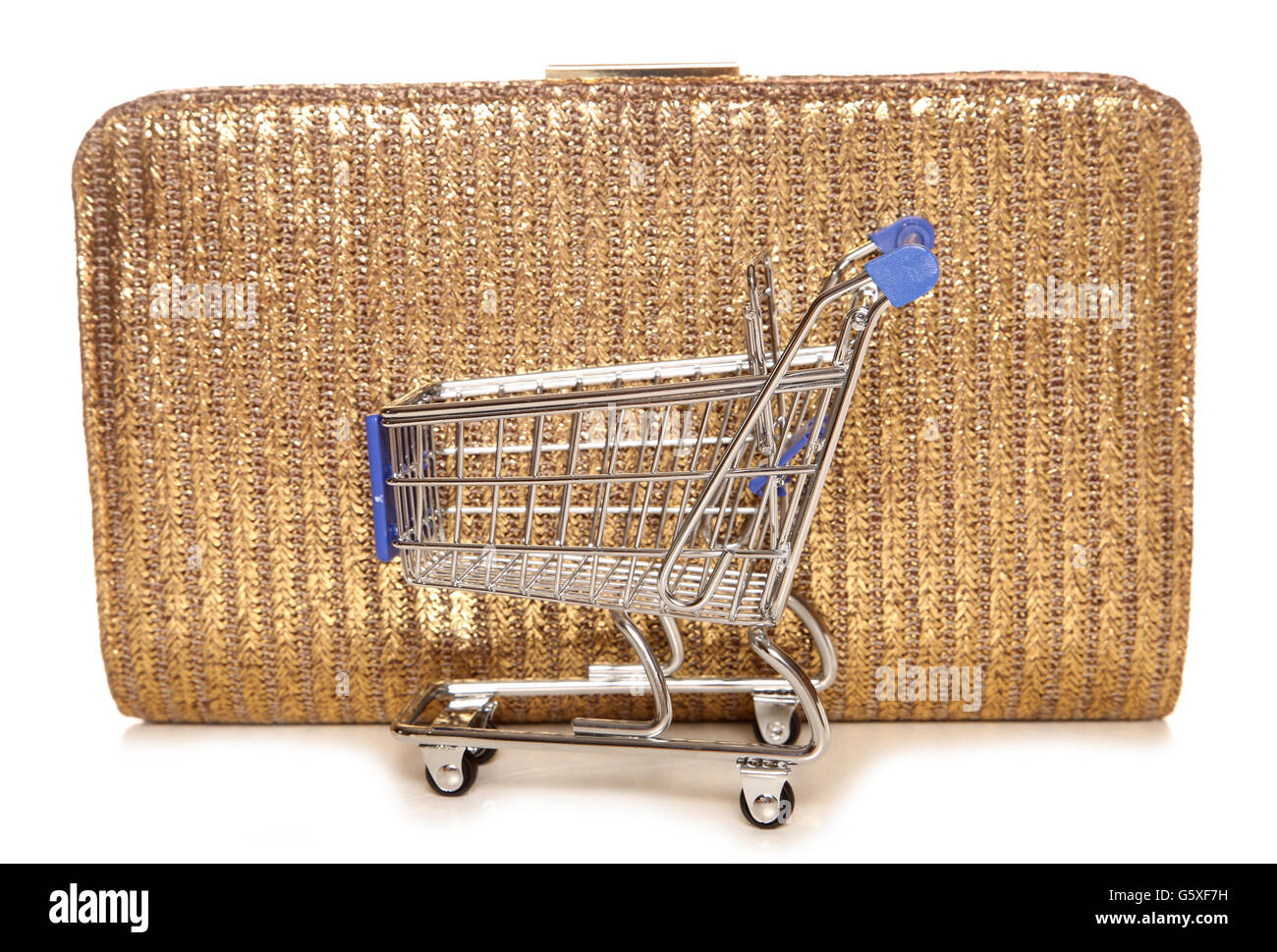Retail therapy shopping trolley and handbag cutout Stock Photo