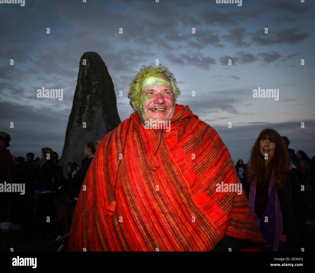 Revellers converge on Stonehenge to celebrate the Summer Solstice - Stock Image
