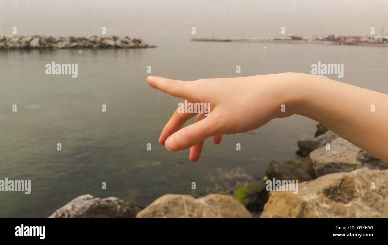 Woman Hand Pointing up With Index Finger - Stock Image