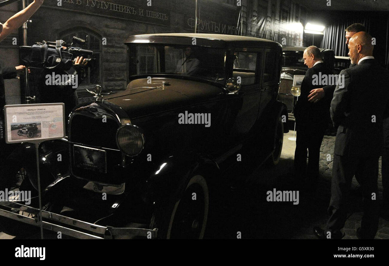 Russian President Vladimir Putin views an old car used as a prop during a visit to Lenfilm studios June 20, 2016 - Stock Image