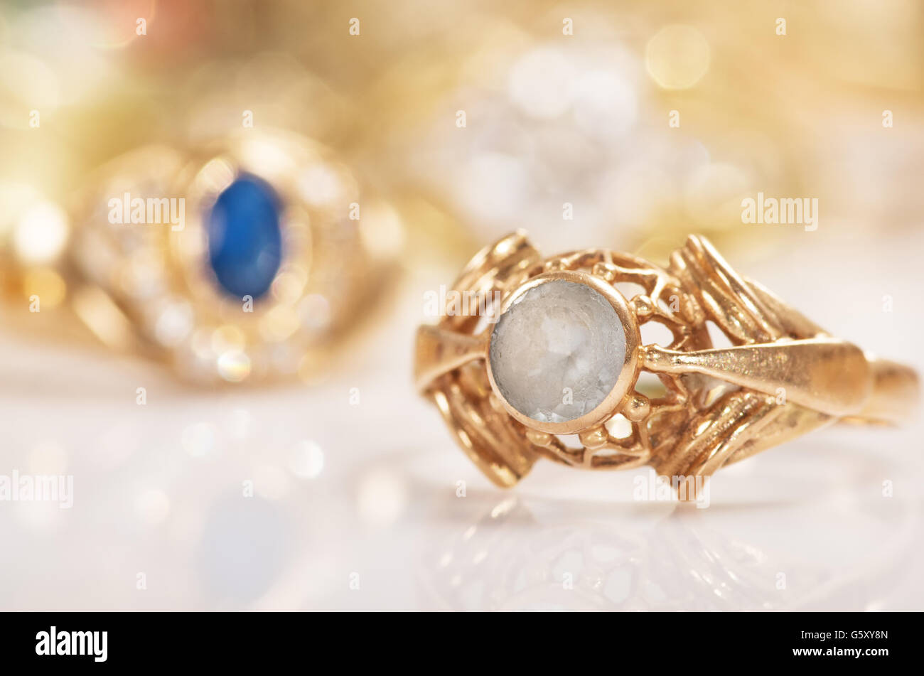 Gold jewelry on a white background. - Stock Image