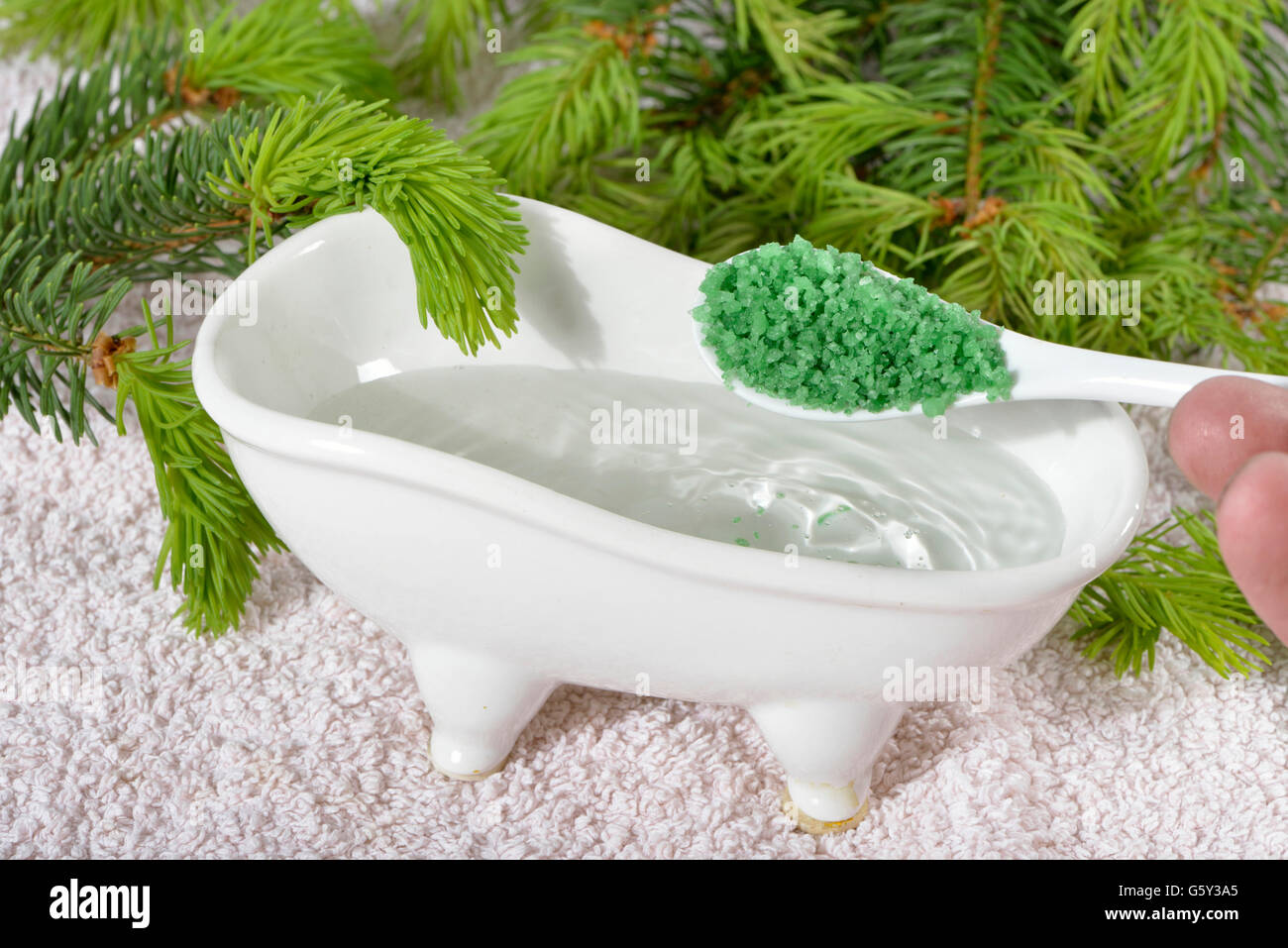 Foam bath with spruce concentrate Stock Photo