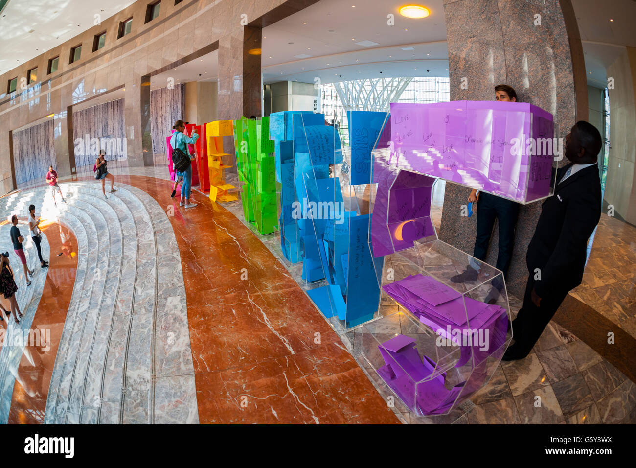 In celebration of Pride Week visitors participate in the 'Love Wins' Letter Project installation in Brookfield - Stock Image