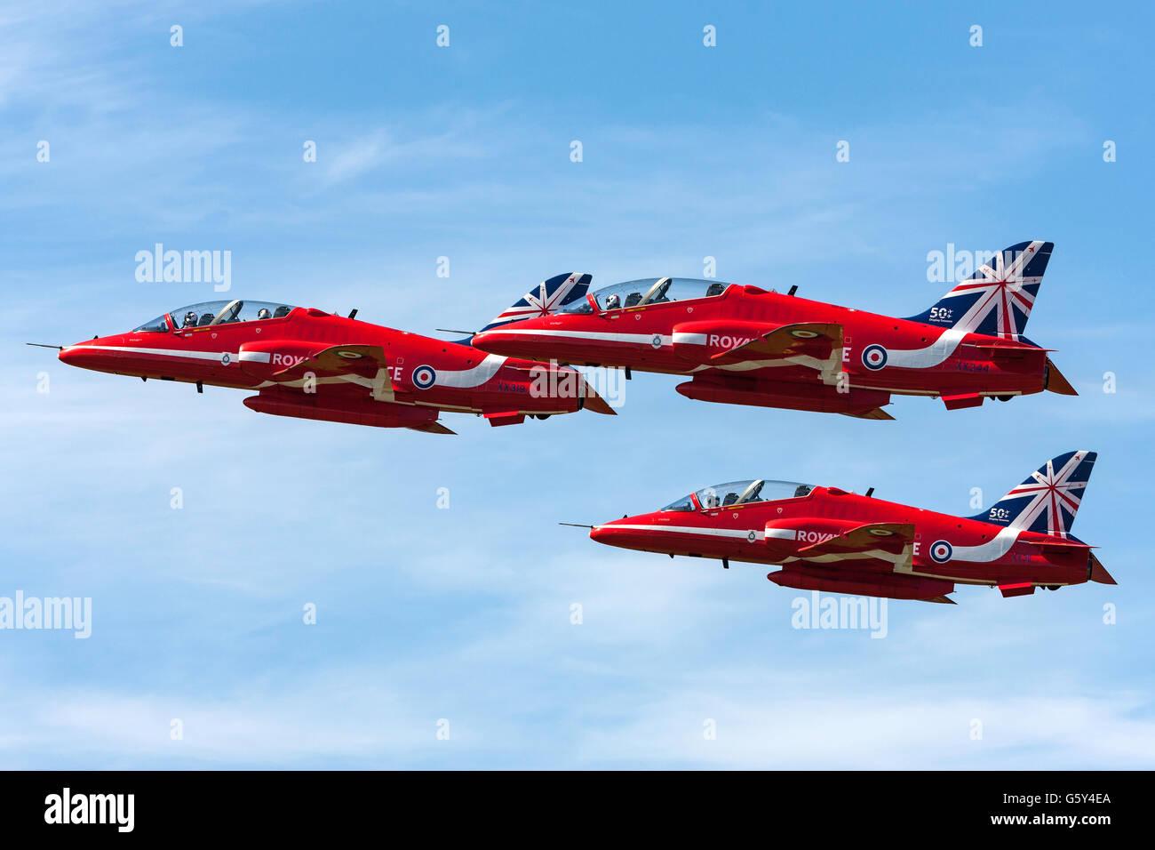 Royal Air Force (RAF) Red Arrows aerobatic display team performing at the Farnborough International Airshow - Stock Image