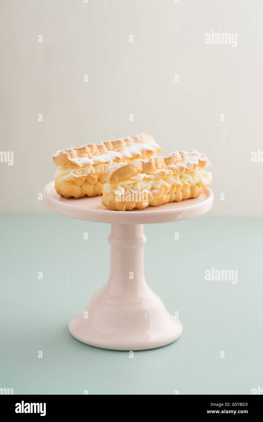 Eclairs with buttercream filling - Stock Image