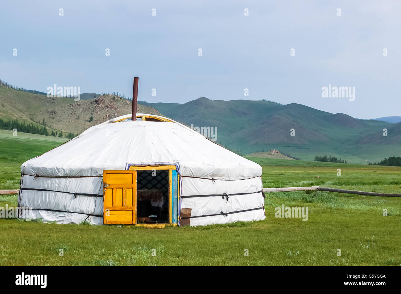 Mongolian yurt called a ger on grassy steppe of northern Mongolia - Stock Image
