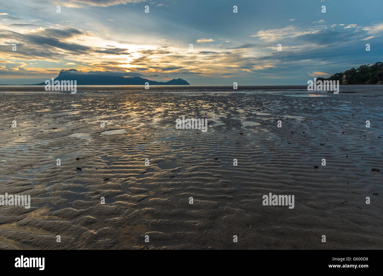 Calm, peaceful sunset view over the beach and South China Sea from Bako National Park, Sarawak, Borneo - Stock Image