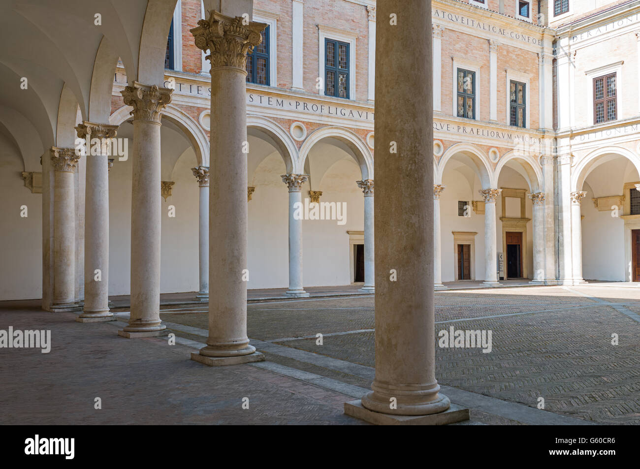 Italy, Marche region, Urbino, the Ducal Palace built by Federico Da Montefeltro, the courtyard Stock Photo