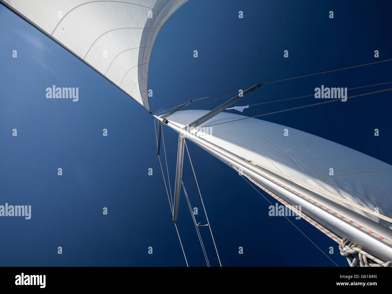 a yacht sail in the blue sky - Stock Image