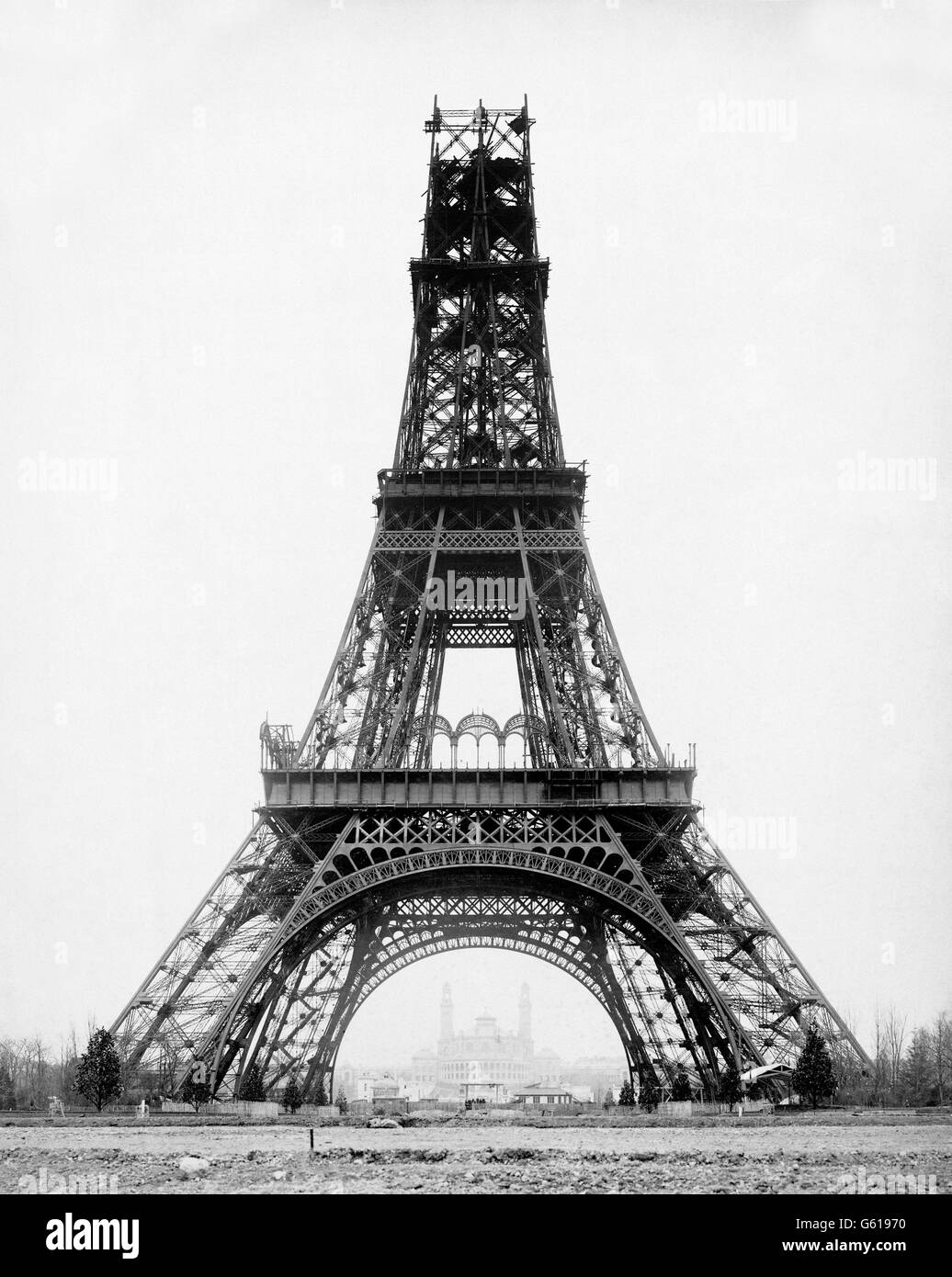 Eiffel Tower under construction, built to serve as the entrance to the Paris Exposition of 1889. This photograph, - Stock Image