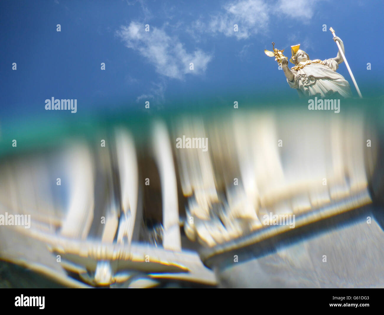Pallas Athene Fountain in front of parliament , split level uptake from the water of the fountain with Reflection - Stock Image