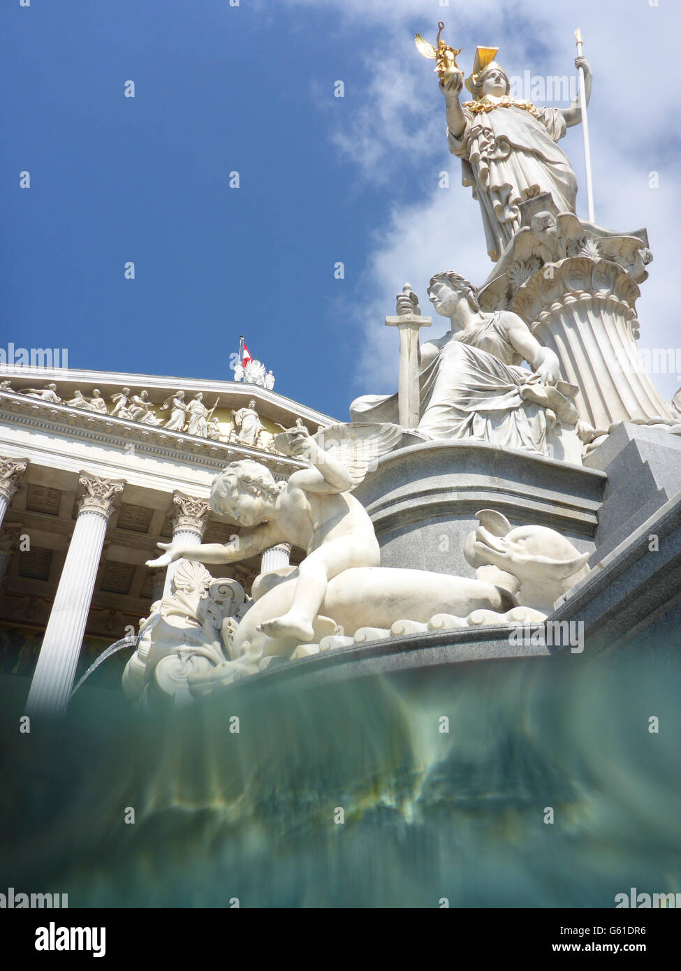 Pallas Athene Fountain in front of parliament , split level uptake from the water of the fountain, Wien, Vienna, - Stock Image