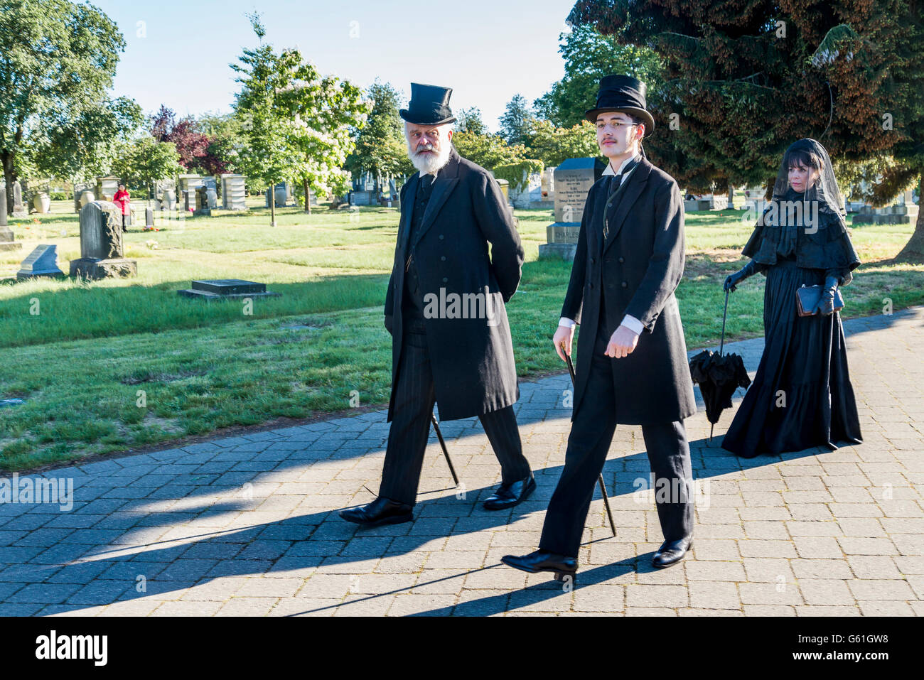 Mourners in traditional black costume, Mountain View Cemetery, Vancouver, British Columbia, Canada, - Stock Image