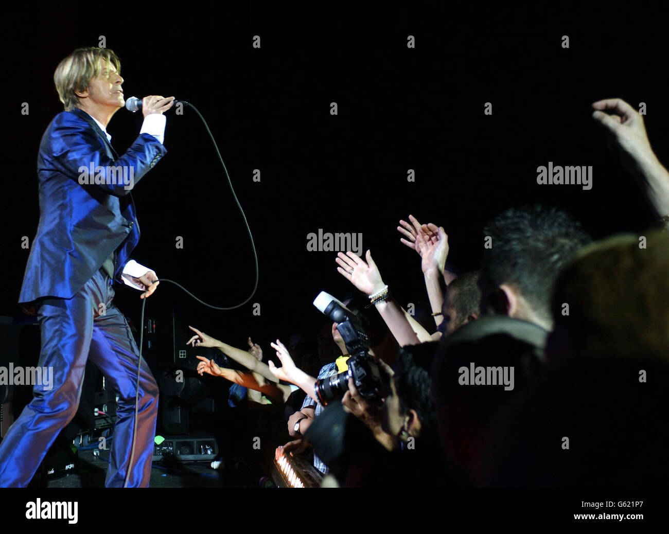 David Bowie performs on stage at the relaunch of the Carling Apollo, Hammersmith, in west London. Stock Photo