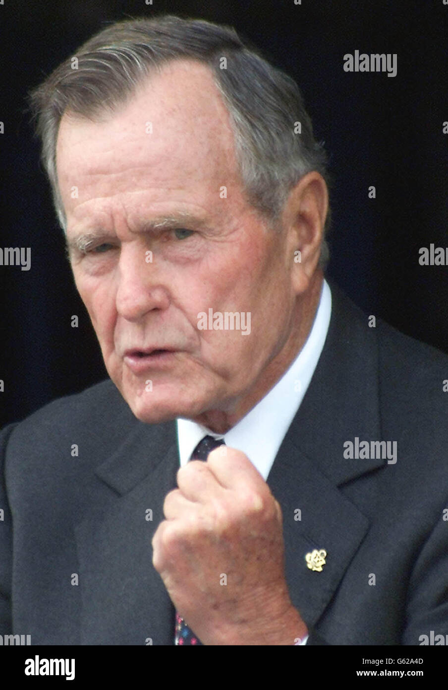 Former U.S. President George Bush gestures as he speaks of Iraq and the Desert Storm campaign during the rededication of the American Air Museum at the Duxford's Imperial War Museum, Cambridgeshire. Stock Photo