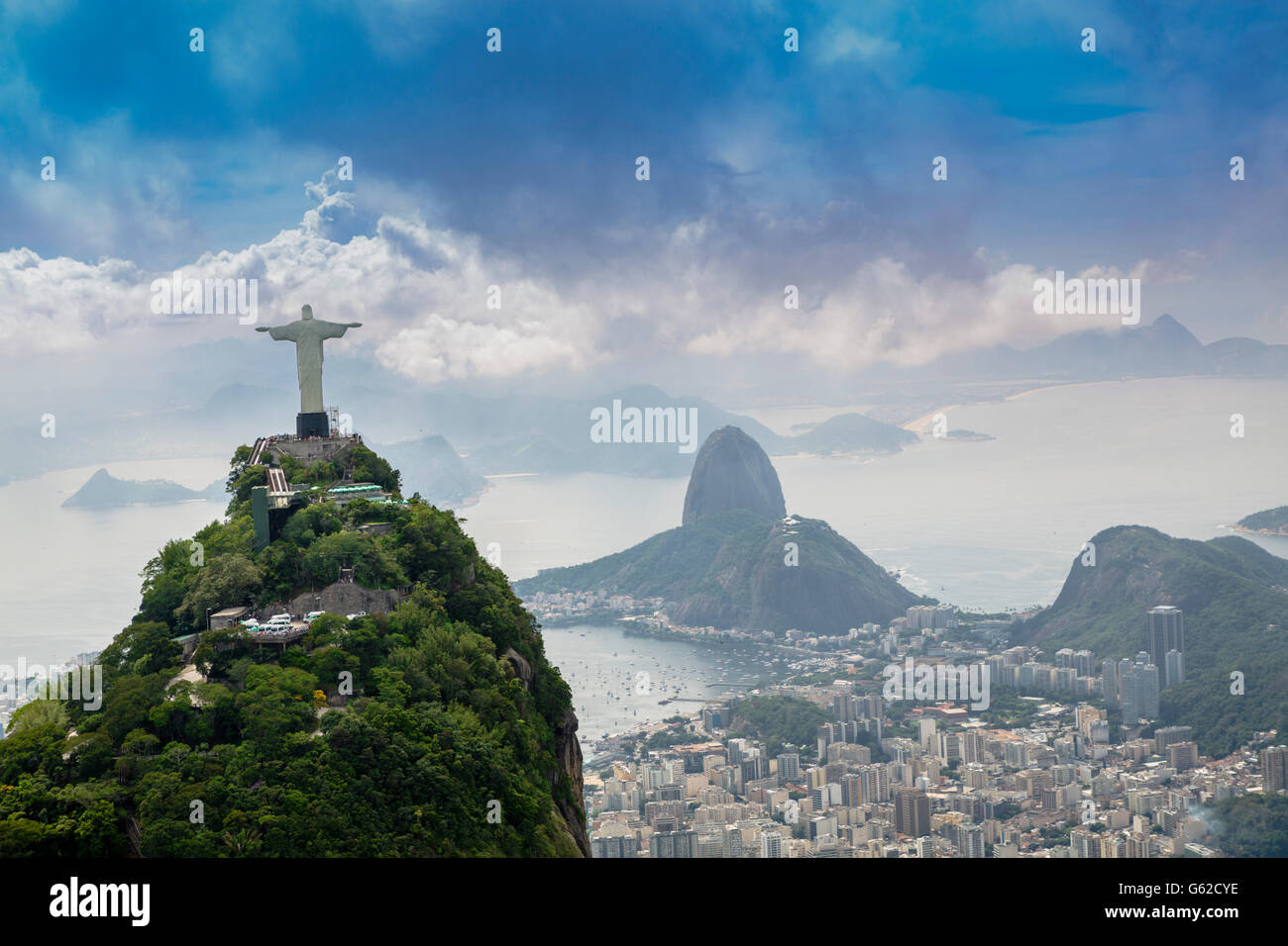UNESCO World Heritage Listed landscape of Rio de Janeiro, with Christ the Redeemer (Cristo Redentor) statue and - Stock Image