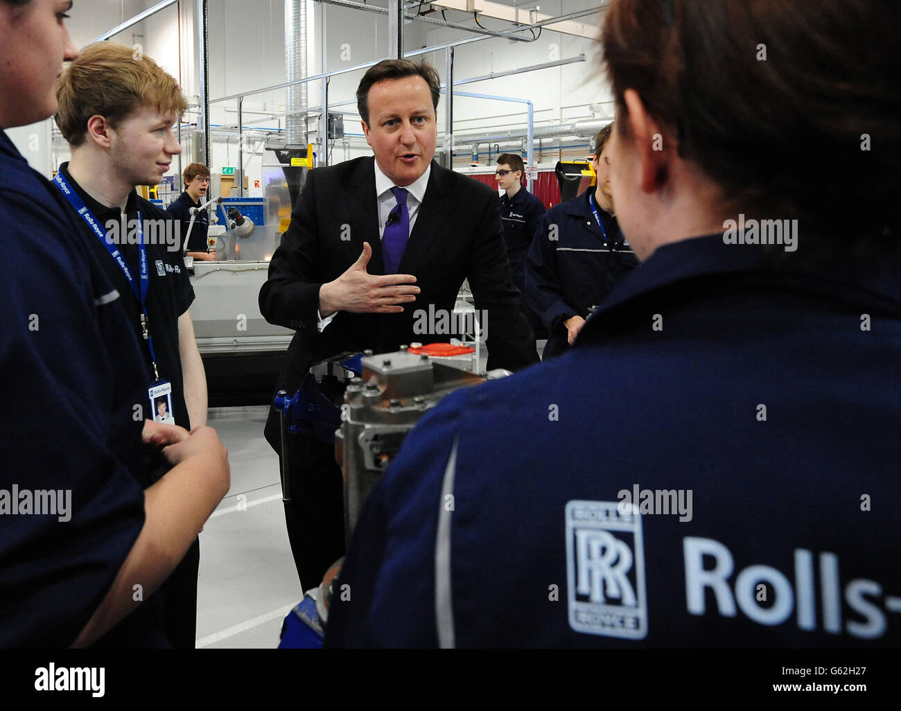 Prime Minister David Cameron meets apprentices during a visit to Rolls Royce Learning and Career Development Centre Stock Photo
