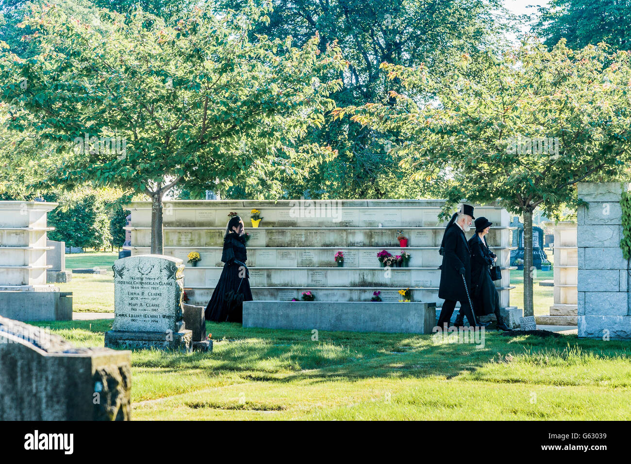 Mourners dressed in black, Mountain View Cemetery, Vancouver, British Columbia, Canada, - Stock Image