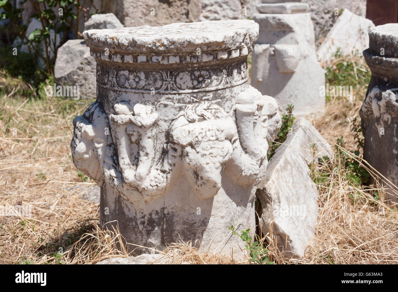 Sculptured marble plinth at The Fortress of Kos, Kos Town, Kos (Cos), The Dodecanese, South Aegean Region, Greece - Stock Image