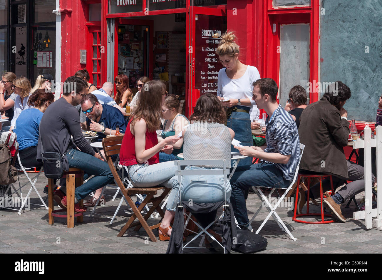 Tables at Brickwood Restaurant, Hildreth Street, Balham, London Borough of Wandsworth, Greater London, England, - Stock Image