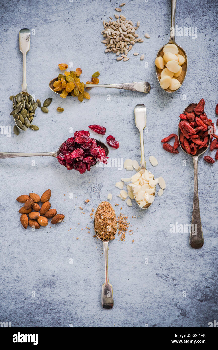 superfood on spoons background, flat lay from above - Stock Image