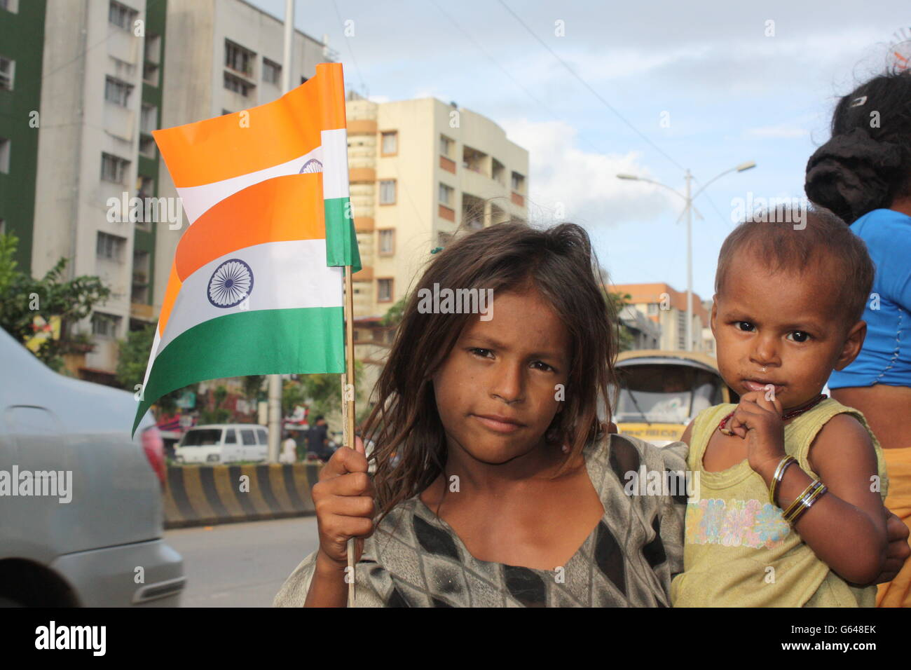 poor indian girl waving indian flag on indian independence