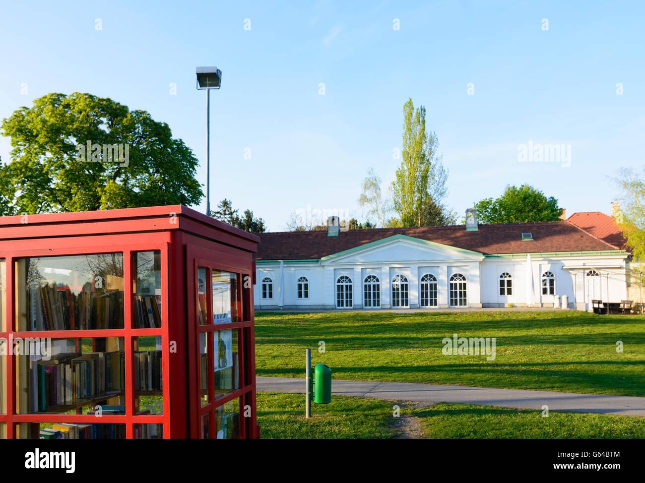 Castle Seyring with book exchange occasion in a red telephone booth, Gerasdorf bei Wien, Austria, Niederösterreich, - Stock Image