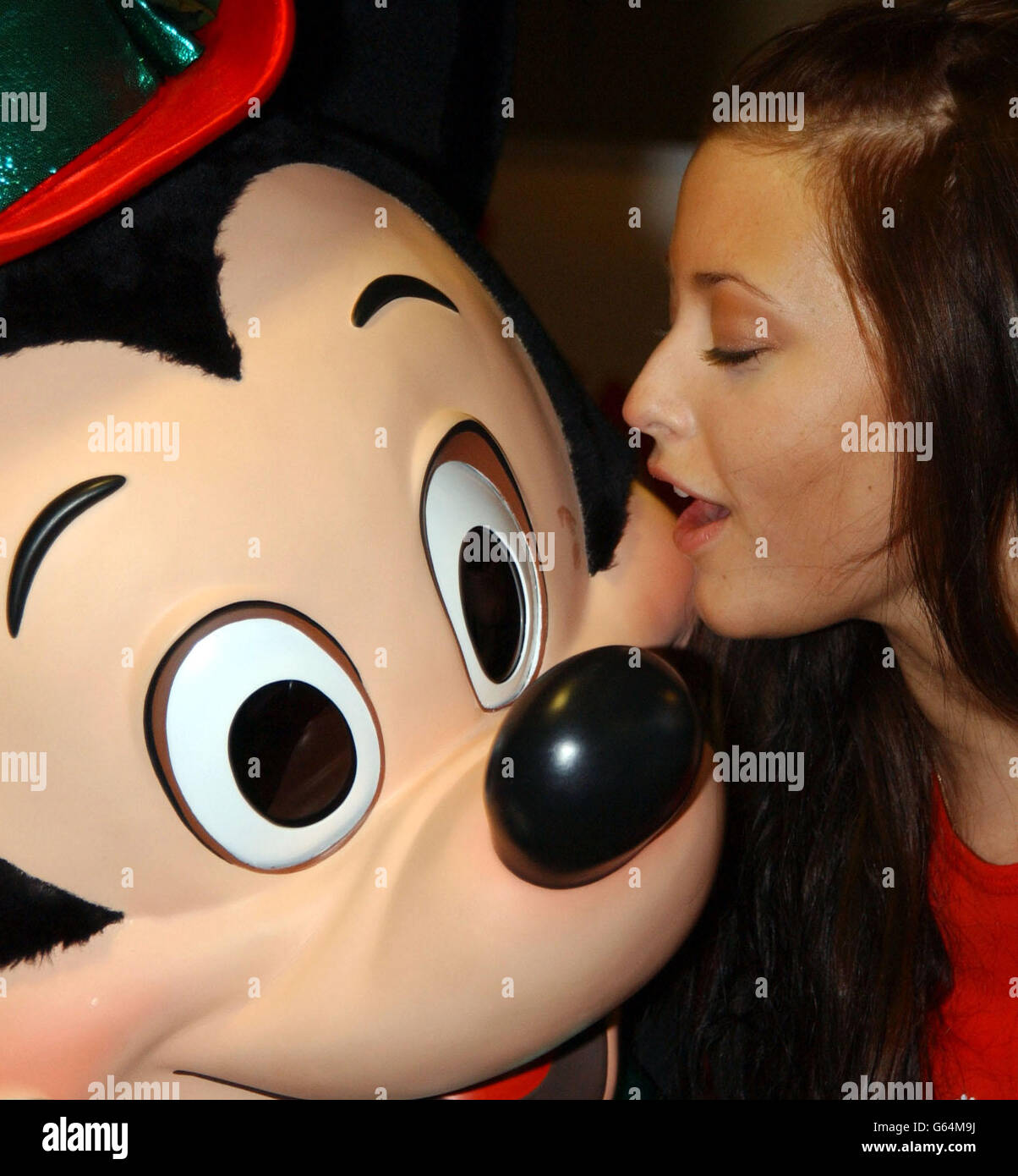 Australian Singer Holly Valance Cuddles Up To Mickey Mouse During A Stock Photo Alamy