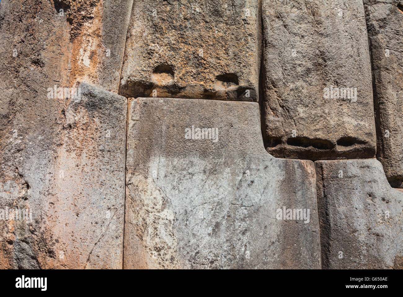 Abstract image of the massive stone walls of Sacsayhuaman Incan fortress in Cusco, Peru - Stock Image