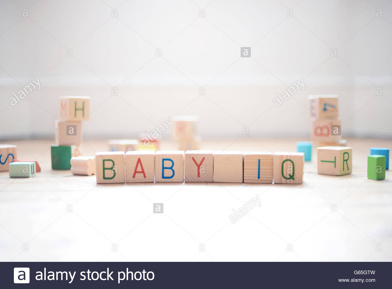 Baby IQ in play blocks - Stock Image