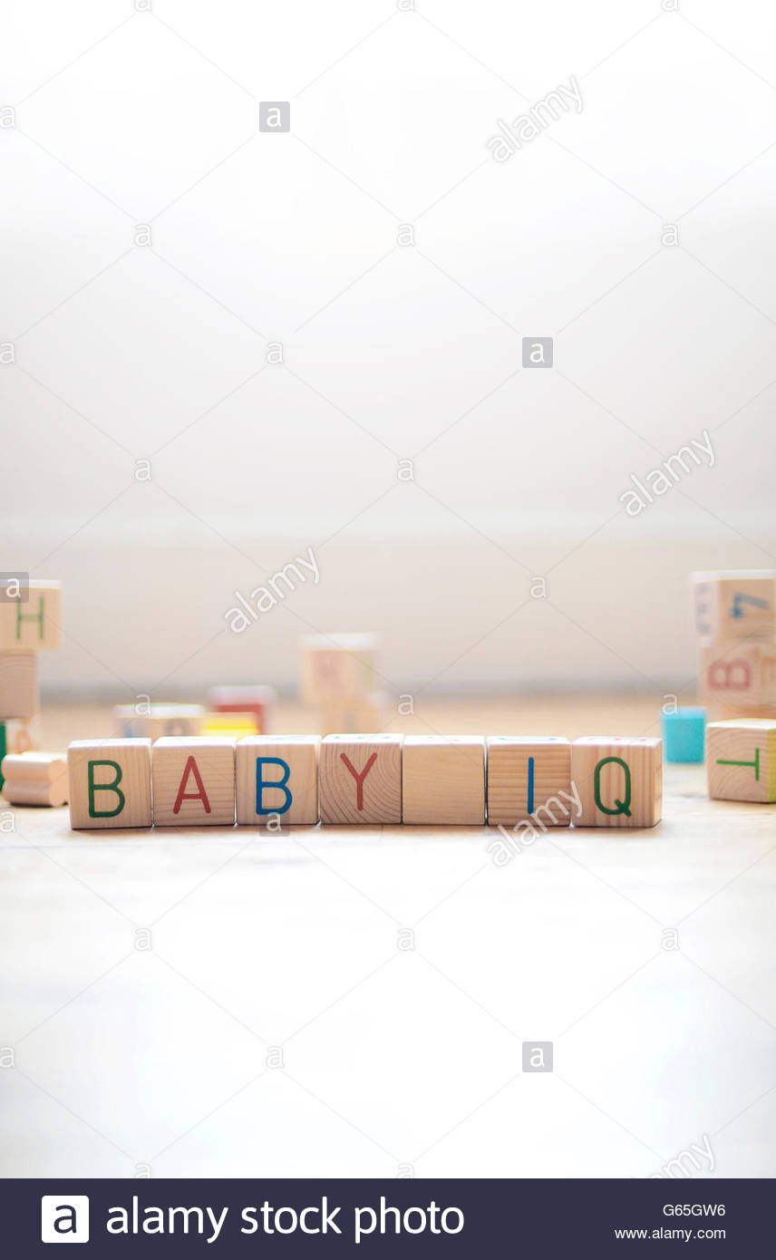 Childs play blocks spelling out Baby IQ - Stock Image