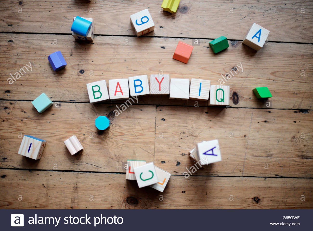 Baby IQ play blocks on wooden floor - Stock Image