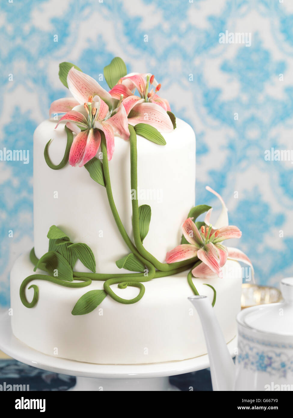 Fancy cake decorated with lilies - Stock Image