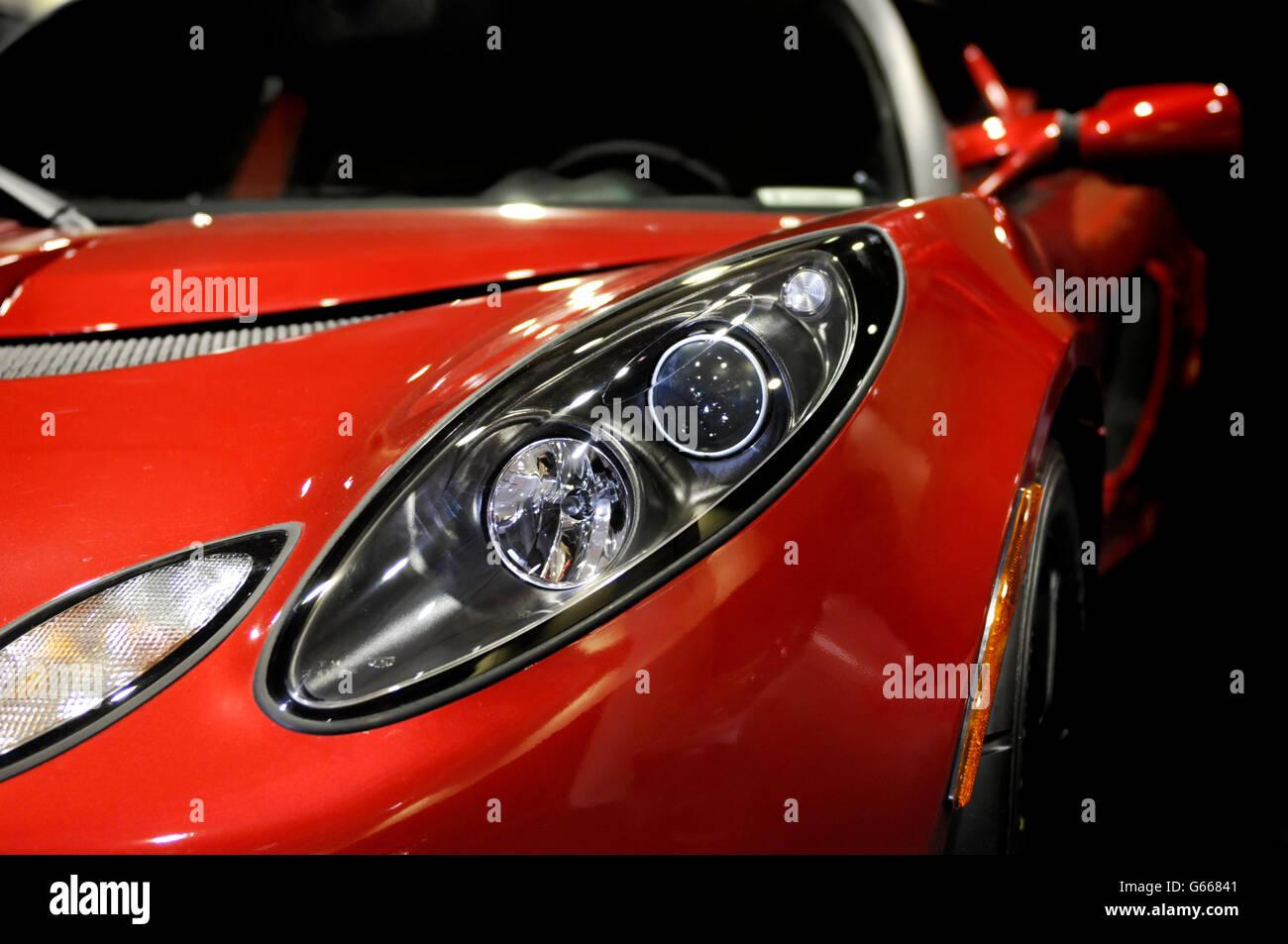 Closeup of 2008 red Lotus Elise sports car headlight - Stock Image