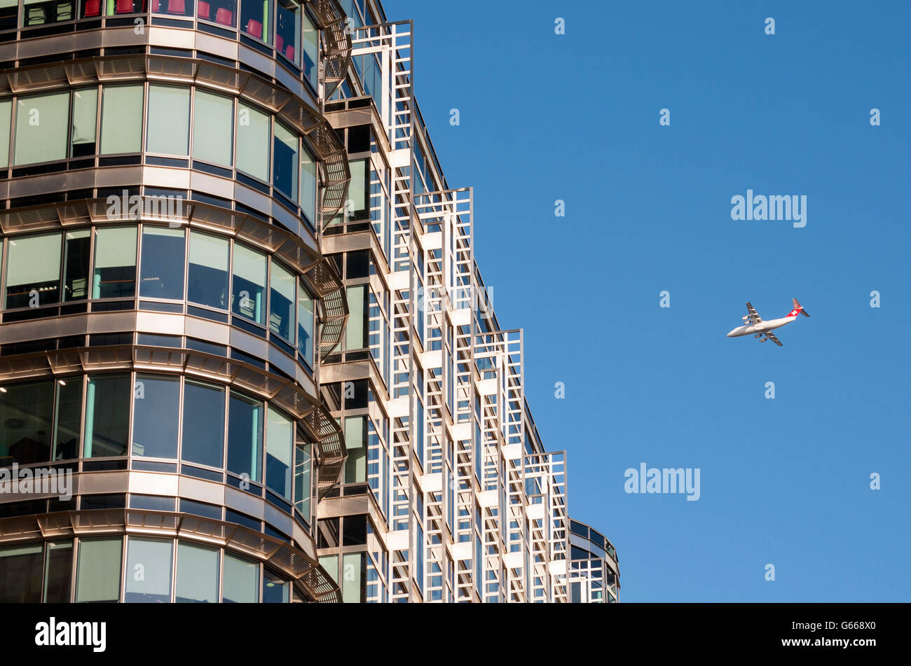 British Aerospace Avro RJ100 Airliner and office building at 20 Canada Square, designed by Adrian D. Smith of Skidmore - Stock Image