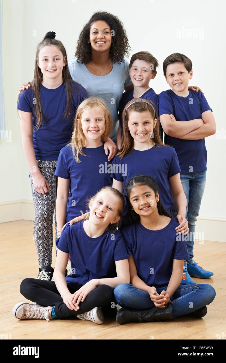 Group Of Children With Teacher Enjoying Drama Workshop Together - Stock Image