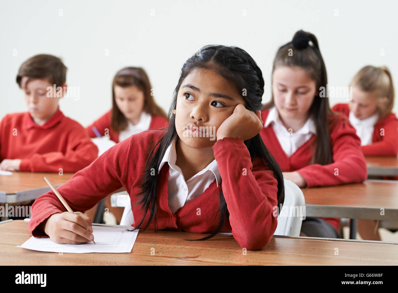 Female Pupil Finding School Exam Difficult - Stock Image