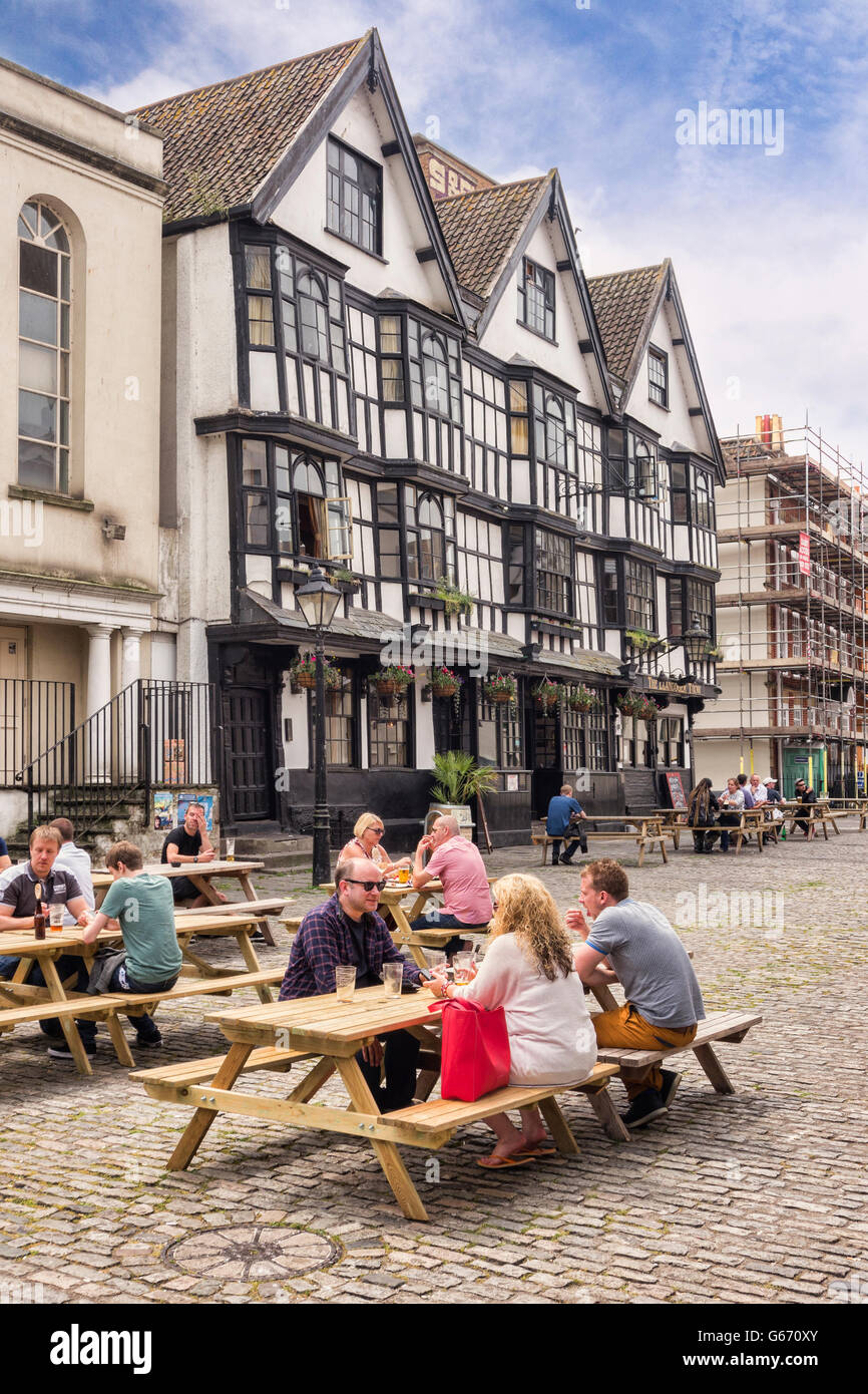 People sitting outside the Llandoger Trow, which dates from 1664, now  a Brewer's Fayre pub in  King Street, - Stock Image