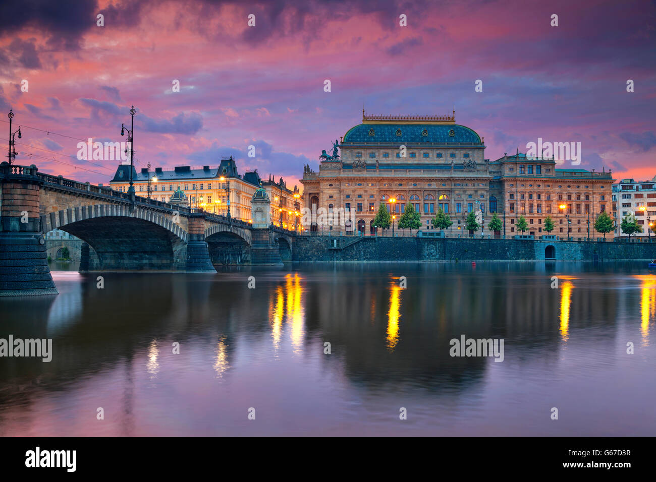 Prague. Image of Prague riverside with reflection of the city in Vltava River and National Theatre. - Stock Image