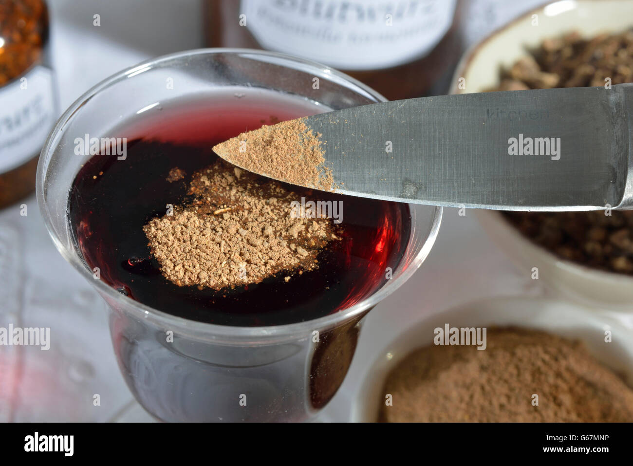 Tormentil root powder in red wine - Stock Image