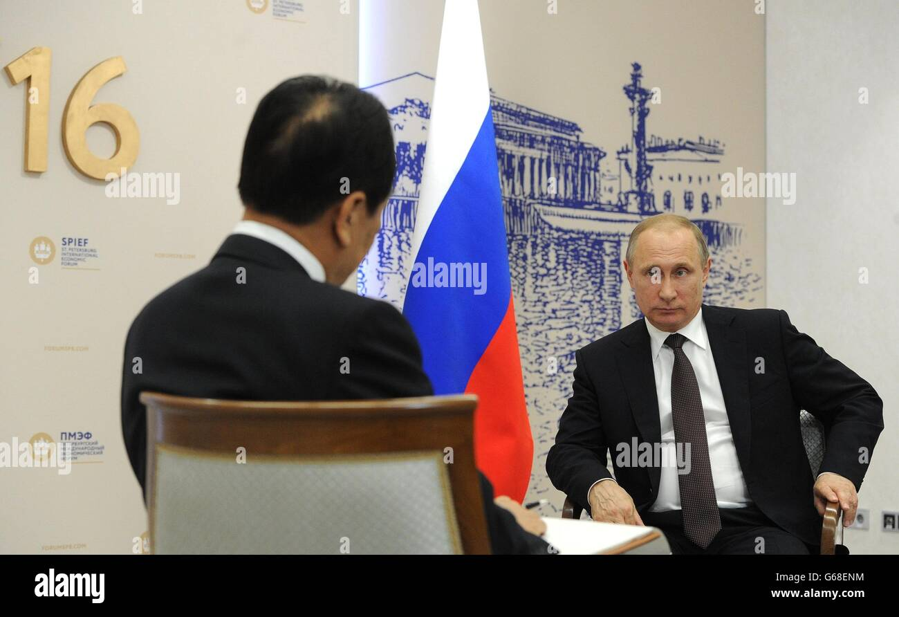 Russian President Vladimir Putin during an interview with Xinhua General Director Cai Mingzhao on the sidelines - Stock Image