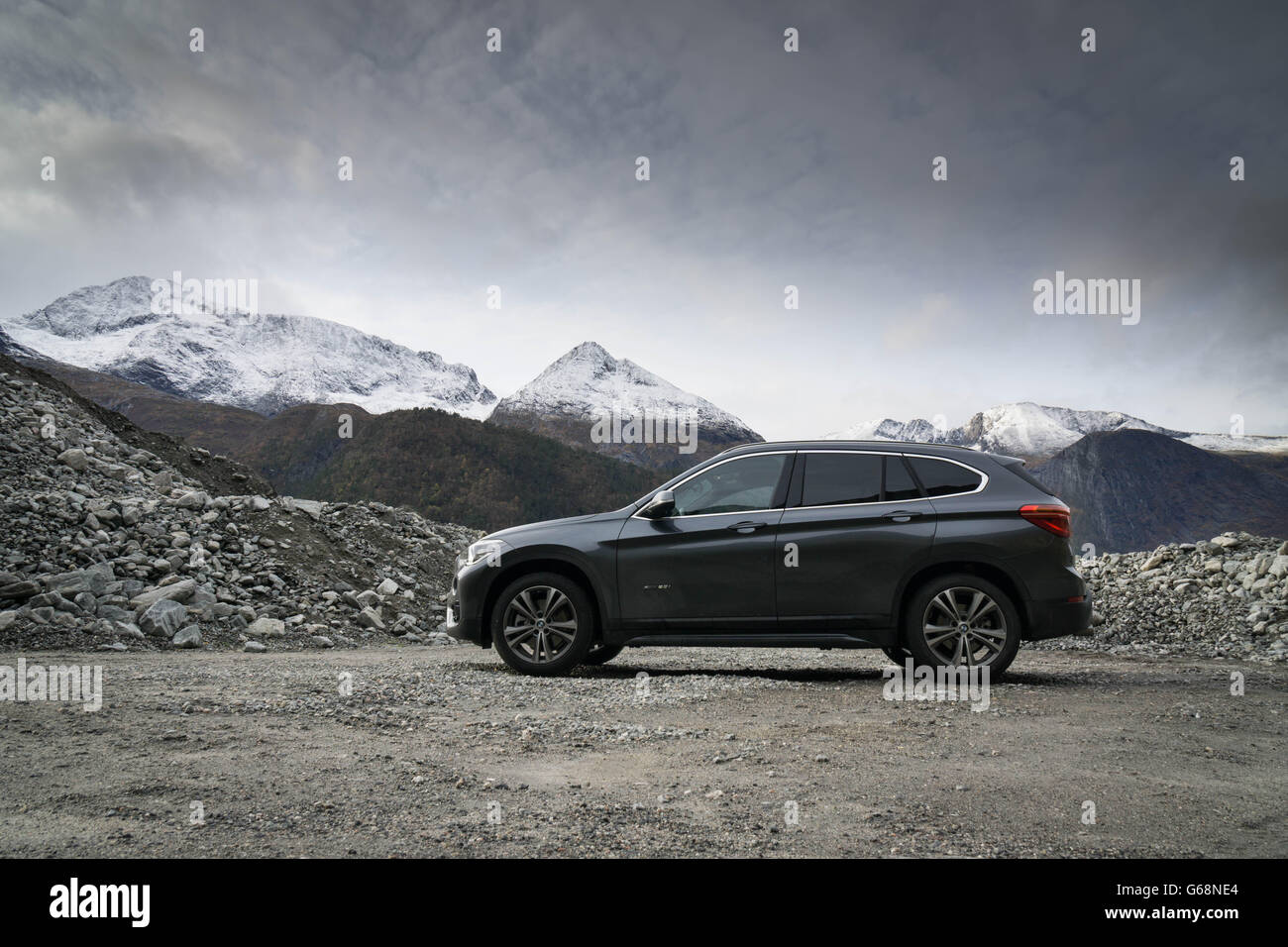BMW in front of mountains - Stock Image